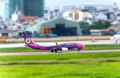 August 12th, 2018: Passenger aircraft Boeing 737 of Nok Air fly over urban areas prepare to landing at Tan Son Nhat International Royalty Free Stock Photos