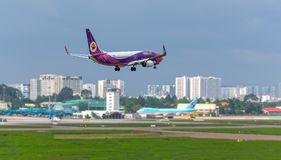 August 12th, 2018: Passenger aircraft Boeing 737 of Nok Air fly over urban areas prepare to landing at Tan Son Nhat International Royalty Free Stock Images