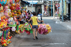 Ho Chi Minh City, Vietnam - August 10 2014 : a woman is hanging Lanterns on the Lanterns ward where there are a lot of lanterns sh Royalty Free Stock Images