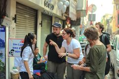 Bui Vien. Ho Chi Minh City, Vietnam - 1 January 2018. tourist talking to local guide in Bui Vien walking street Royalty Free Stock Image