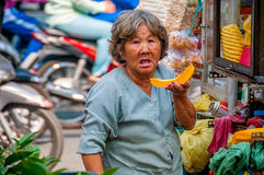 Ho Chi Minh city, VIETNAM - MARCH 29, 2017: Women selling fastfood and fruits in the morning on street, Hanoi, Vietnam. stock photo