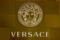 HO CHI MINH CITY, VIETNAM-OCTOBER 31ST 2013: Versace logo on store in Ho Chi Minh City. The logo is based on Medusa who was stock photos