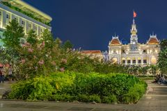 Ho chi minh city vietnam pedestrian street at night. View of the ho chi minh city ex saigon pedestrian street at night colored with a lot of green plants and Royalty Free Stock Photo
