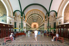 Tourists visit Interior of Saigon Central Post Office. Royalty Free Stock Photos