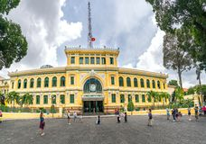 Tourists visit outside Saigon Central Post Office Architecture. Royalty Free Stock Photo