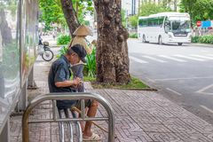 Ho Chi Minh City, Vietnam - September 1, 2018: an undefined man is getting everything ready before getting on the bus. stock photo