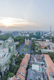 Ho Chi Minh city view from top of building. Ho Chi Minh city view from above in the nightfall. Ho Chi Minh City has the most dynamic economy in Vietnam.nPhoto Stock Image