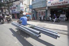 Ho Chi Minh - durée sur des scooters Images libres de droits