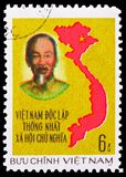 Ho Chi Minh and map from Vietnam, Unification of Vietnam serie, circa 1976. MOSCOW, RUSSIA - FEBRUARY 21, 2019: A stamp printed in Vietnam shows Ho Chi Minh and stock photo