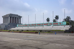 Ho Chi Minh mausoleum with long slogan banner. Royalty Free Stock Photos
