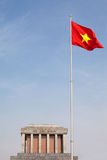 Ho Chi Minh Mausoleum with Vietnam Flag in Hanoi. Vietnam's flag flying high in front of its late leader, Ho Chi Minh's, mausoleum Stock Photo