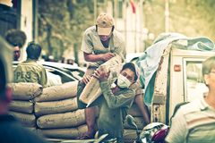Vietnamese workers engaged in transporting cement bags Royalty Free Stock Photos