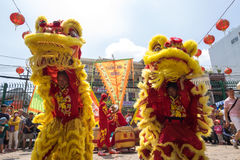 Ho Chi Minh, Vietnam - February 18, 2015 Lion dancing to celebrate Lunar New Year at Thien Hau Pagoda Royalty Free Stock Photos