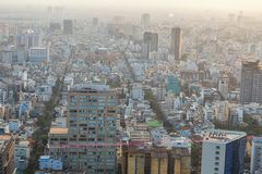 Ho Chi Minh, Vietnam - 29 January, 2015: View on slums of Saigon. Vietnam, from the viepoint tower. Smog in the city during sunset Royalty Free Stock Images
