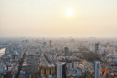 Ho Chi Minh, Vietnam - 29 January, 2015: View on slums of Saigon. Vietnam, from the viepoint tower. Smog in the city during sunset Royalty Free Stock Photo