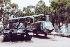 HO CHI MINH , VIETNAM- NOVEMBER 23, 2018 : Ancient helicopter and tank at Vietnamese War Remnants Museum, museum keep history stock photos