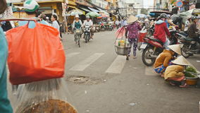 HO CHI MINH, VIETNAM - OCTOBER 13, 2016: Street city with people 3 stock video