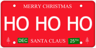 Ho Ho Ho License Plate. An imitation license plate with December 25th stickers and HO HO HO written on it making a great concept.  Words elsewhere Merry Stock Images