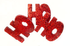 Ho ho ho. Shiny glitter covered red ho ho ho decoration on white background royalty free stock photo