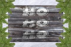 Ho, ho and ho on wooden board and christmas concept pine tree Royalty Free Stock Image