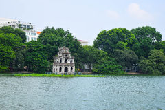 Ho Hoan Kiem, the little lake in the old part of Hanoi, Vietnam, with the Tortoise Tower. Tortoise Tower is the symbol of stock image