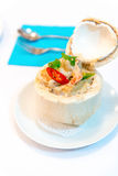 Ho mok, Thai spicy food in young coconut . Royalty Free Stock Photos