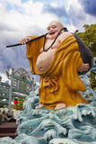 Ho Tai Laughing Buddha Statue at Haw Par Villa Stock Photo
