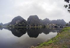 Hoa Lu Temple, bridge and lake surrounded by limestones - Ninh Binh Province, Vietnam Royalty Free Stock Image