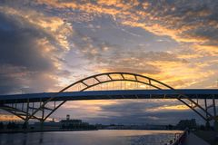 Hoan Bridge in Milwaukee, Wisconsin at Sunset. With beautiful cloudy skies stock photo