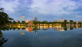 Hoan Kiem lake panorama view at sunset period with ancient Turtle Tower and Hanoi post office. Hoan Kiem lake or Sword lake or Ho stock photos