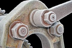 Hoar-Frosted Vintage Hex Nuts Stock Image