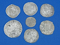Hoard of historic coins. A macro image of silver coins found in a hoard under the ground and dating from around 1540 . Before the days of banks people buried royalty free stock photography