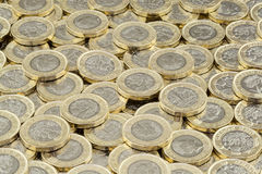 Hoard of money. Scattered pile of British pound coins. Stock Image