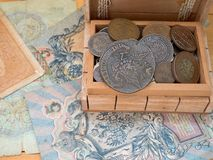 The hoard of old coins. In a wooden box royalty free stock photos