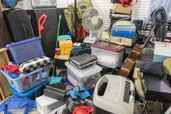 Hoarder Home Packed with Stored Boxes and Items. Hoarder home packed with stored boxes, vintage electronics, files, business equipment and household items royalty free stock photography
