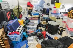 Hoarder Room Packed with Stored Items. Hoarder room packed with stored boxes, electronics, files, business equipment and household items royalty free stock image