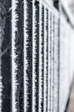 Hoarfrost on a black fence. Hoarfrost on a black fence in winter time Royalty Free Stock Photo