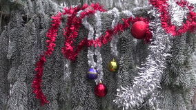Hoarfrost and Christmas New Year toys on fir tree branch stock footage