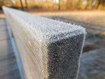 Hoarfrost on a garden bench Stock Image