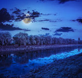Hoarfrost on a winter midnight with full moon stock photos