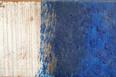 Hoarse, scratched and peeled surface  with blue and white paint Royalty Free Stock Image