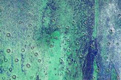 Hoarse,scratched and peeled surface with green and blue paint Stock Photography