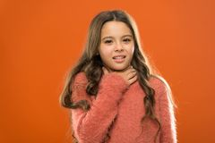 Hoarse voice. Throat pain treatment. Sore throat quick remedies. Kid feel pain in throat. Suffer from pain neck. Girl. Painful face orange background. Health royalty free stock photography