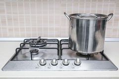 Hob cooker pot pan. Stainless steel cooking pot pan cooker hob Stock Photo