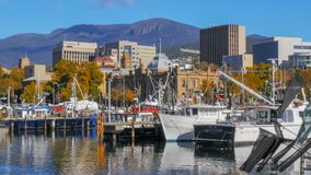 HOBART, AUSTRALIA - APRIL 16, 2015: close up view of fishing vessels at victoria dock in the tasmanian capital city of hobar. T on a fine autumn day with mt stock image