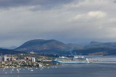 City of Hobart and the Derwent estuary with cruise ship docking in Hobart harbour. Hobart, Tasmania, Australia - 17 December 2017: Derwent estuary with cruise Stock Photography