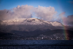 Hobart, Tasmania with Rainbow and snowy Mt. Wellington in Background. Morning view of Hobart, Tasmania, Australia with a colorful rainbow and Mt. Wellington Stock Photos