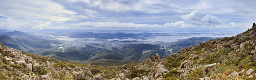 Hobart from Wellington Panorama. Australia tasmania hobart view on the city below from Mt Wellington day time aerial panorama above terrain valley and Derwent Stock Image