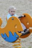 Hobbelpaard op speelplaats Stock Foto