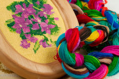 Hobbies. Violet flower embroidered with silk threads Royalty Free Stock Photos